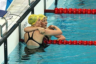 Ellie Cole - Cole and Annabelle Williams embrace at the end of the S9 100m butterfly final at the 2008 Beijing Paralympic Games