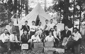 Moxie - A group of friends from Allentown, Pennsylvania, celebrating the 4th of July holiday in 1913 with a case of Moxie at a grove.