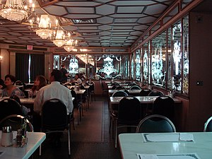 Versailles restaurant - Interior of Versailles, featuring etched-glass mirrors.