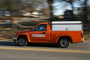 A Terminix pickup truck driving eastbound on E...