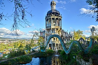 """Bruno Weber Park - """"snake bridge"""" crossing the pond in the park, the villa's tower in the background"""