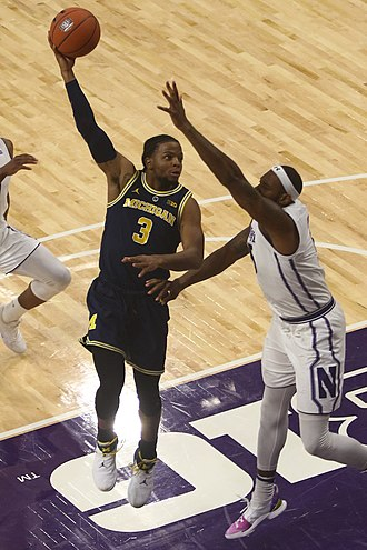 "While serving as co-captain for the 2018-19 Michigan Wolverines as a junior, Zavier Simpson earned the nickname ""Captain Hook"" for making use of the hook shot. 20181204 Zavier Simpson at UM-NW game (8).jpg"