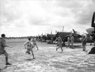 Malayan Campaign - Pilots of No. 453 Squadron RAAF responding to a scramble order.