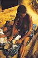 ASC Leiden - W.E.A. van Beek Collection - Dogon markets 52 - A woman with a child separates the cotton fiber from the seed, Tireli, 1983.jpg