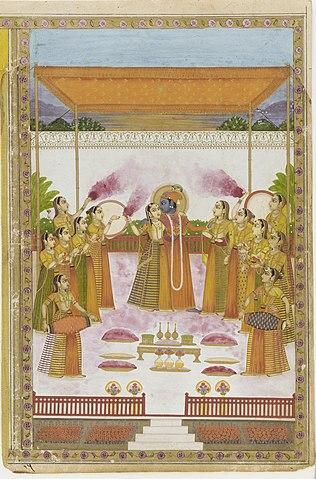 শ্রী রাধা ও অন্যান্য গোপীগণের সঙ্গে দোল খেলছেন শ্রী কৃষ্ণ