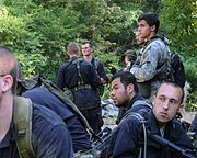 A Special Forces candidate and several role players conduct planning during ROBIN SAGE