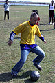 A Special Olympian kicks a soccer ball during a match at Penny Lake in Iwakuni, Japan, Oct. 16, 2011 111016-M-GU681-971.jpg