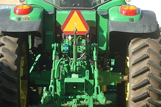Power take-off - A PTO (in the box at the bottom) in between the three-point hitch of a tractor