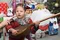 A Turkmen Boy Plays an Instrument (5366857071).jpg