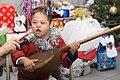 A Turkmen Boy Plays an Instrument (5366857071).jpg