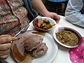 A friend from Baku eating a nigerian local meal wheat flour and okazi soup with mixed meat.jpg