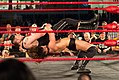 Adam Cole straightjacket german suplex.jpg