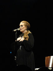 colour photograph of Adele singing live in 2011.