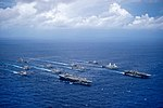 Aerial starboard view of USS Ronald Reagan (CVN-76) and USS Bonhomme Richard (LHD-6) leading formation of Carrier Strike Group Five Expeditionary Group Seven ships at end of Valiant Shield 160923-N-NT265-725.jpg