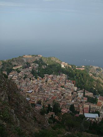 Taormina - Taormina as seen from the Saracen castle overlooking the town. The theatre is visible in the distance.