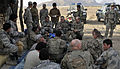 Afghan National Security Forces members and coalition forces service members meet to discuss the day's events during Operation Southern Fist III in the Spin Boldak district, Kandahar province, Afghanistan 130305-A-MX357-256.jpg