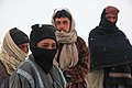 Afghan boys watch as U.S. Soldiers from Combat Outpost Zormat, collect biometric data from military-age men in Paktya province, Afghanistan, Jan. 30, 2012 120130-A-LP603-086.jpg