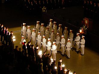 Traditions of Texas A&M University - 2007 Aggie Muster at Reed Arena.  The Ross Volunteers stand at 'present arms' as candles are lit for the deceased.