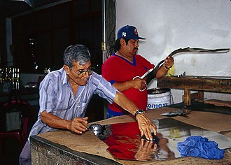 Artisans working with tin sheets. Alfonso Santiago Leyva and his son Tomas working.jpg