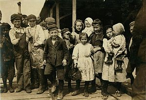 Pass Christian, Mississippi - Children employed as oyster shuckers at Pass Packing Company, 1911.  Photo by Lewis Hine.