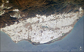 "Intensive farming in Almería - Campo de Dalías satellite image and its ""plastic sea"" formed by greenhouses."