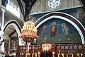 Altar iconostasis and mural painting of Theotokos inside Virgin Mary Eleousa church in Nottingham.jpg