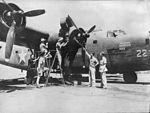 American-mechanics-seen-working-on-an-American-B-24-bomber-391749527810.jpg