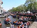 Amsterdam - Koninginnedag 2012 - canal near Muntplein.JPG