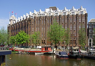 The Scheepvaarthuis, by architects Johan van der Mey, Michel de Klerk, Piet Kramer is characteristic of the architecture of the Amsterdam School. Amsterdam Scheepvaarthuis 002.JPG