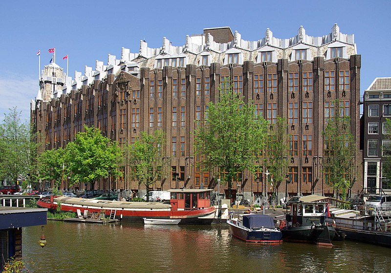 The Scheepvaarthuis, by arhitects Johan van der Mey, Michel de Klerk, Piet Kramer is characteristic of the architecture of the Amsterdam School.