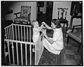 Amusing baby with toys LCCN2016872285.jpg