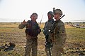 An interpreter helps U.S. Army 1st Lt. Alex Graves, a leader with the 2nd Platoon, Fox Company, 2nd Battalion, 506th Infantry Regiment, 4th Brigade Combat Team, 101st Airborne Division, talk to an Afghan 130530-A-DQ133-116.jpg