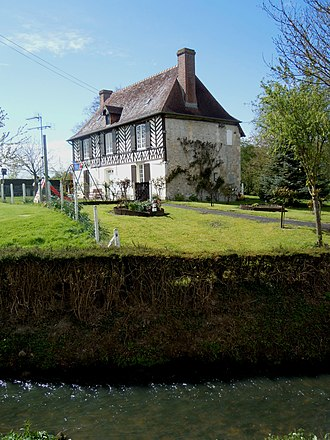 Angerville, Calvados - The Town hall next to the Ancre.