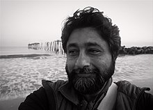 image shows Anjan Chatterjee at the shore. He took this picture of himself