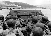 American troops in an LCVP landing craft approach Omaha Beach June 6, 1944.