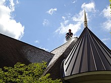 roof cleaning being performed using a soft wash system - Roof Cleaning