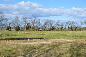 Arlington Archeological Site - Overview, with interpretive signage in the distance
