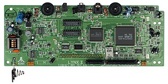 "Atari Lynx - The motherboard of an Atari Lynx II.  The larger chip is the ""Mikey"" and the smaller is called ""Suzy""."