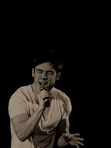 Black and White image of Austin Drage singing