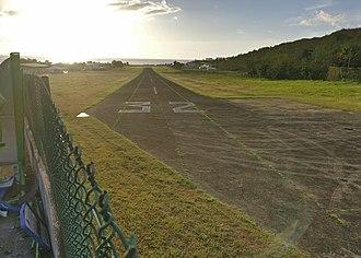 Baillif - The Airfield, as seen towards the sea. Runway 32