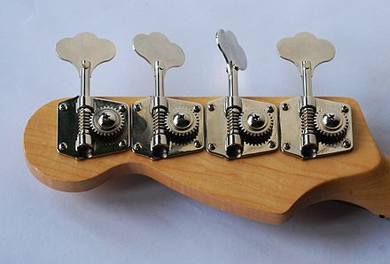 Tuning machines (with spiral metal worm gears) are mounted on the back of the headstock on the bass guitar neck Bass guitar headstock.jpg