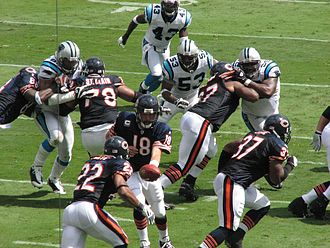 Matt Forte - Forte takes a handoff from Kyle Orton while playing against the Carolina Panthers in September 2008