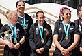 Black Ferns Kendra Cocksedge, Stacey Waaka, Selica Winiata, Eloise Blackwell with Women's Rugby World Cup trophy and WRWC medals.jpg