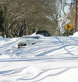 North American blizzard of 2005 - Abandoned cars line Route 6A in Yarmouth Port, Massachusetts, one of the hardest hit areas, receiving as much as 40 inches (1 m) of snow during the Blizzard.