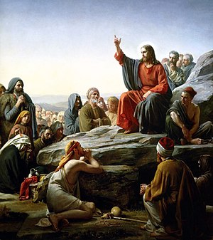 Christians believe that Jesus is the mediator of the New Covenant (see Hebrews 8:6). Depicted is his famous Sermon on the Mount in which he commented on the Law. Some scholars (see Antithesis of the Law) consider this to be an antitype of the proclamation of the Ten Commandments or Mosaic Covenant by Moses from the Biblical Mount Sinai.