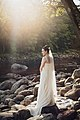 Bride poses at Shelburne Falls (Unsplash).jpg