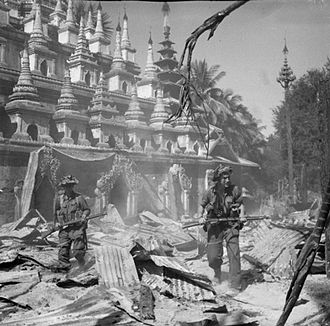 Burma Campaign 1944–45 - Two British soldiers patrol the ruins of Bahe, in Central Burma