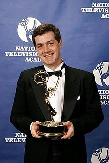 Tv producer bruce kennedy holding an emmy