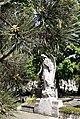 Bucuresti, Romania. Cimitirul Bellu Catolic. Ingerul la umbra unui brad cam ciudat. Mai 2021.jpg