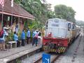 Bukit Timah Railway Station in Singapore - train driver taking key token.png